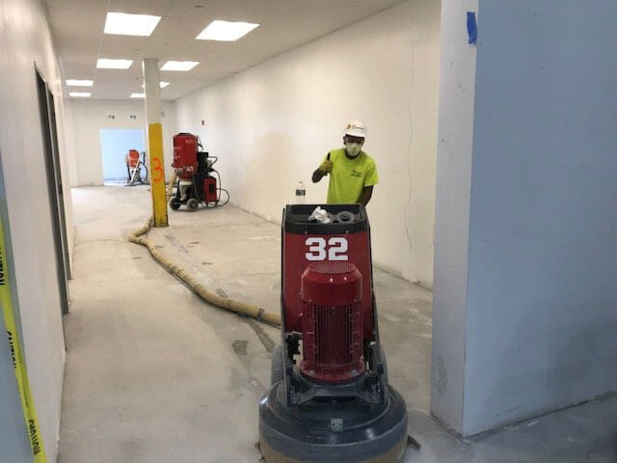 Kaloutas contractors repairing a concrete floor Kaloutas Can Handle the Difficult Projects and Solve Complexity Issues.