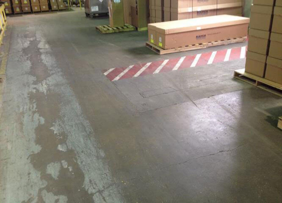 Damaged concrete floor in a warehouse 6 Signs Your Warehouse Needs Concrete Floor Resurfacing