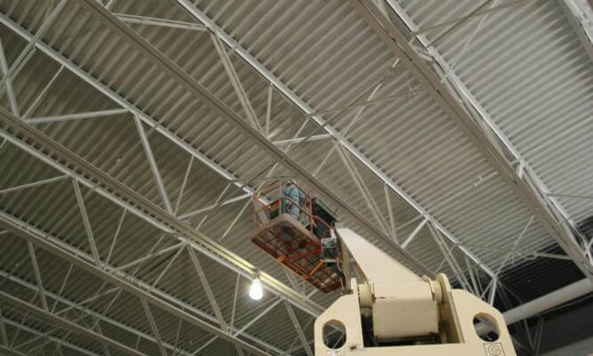 Fireproofing the ceiling of a commercial warehouse. Opening a New Warehouse? Protect it with Fireproofing