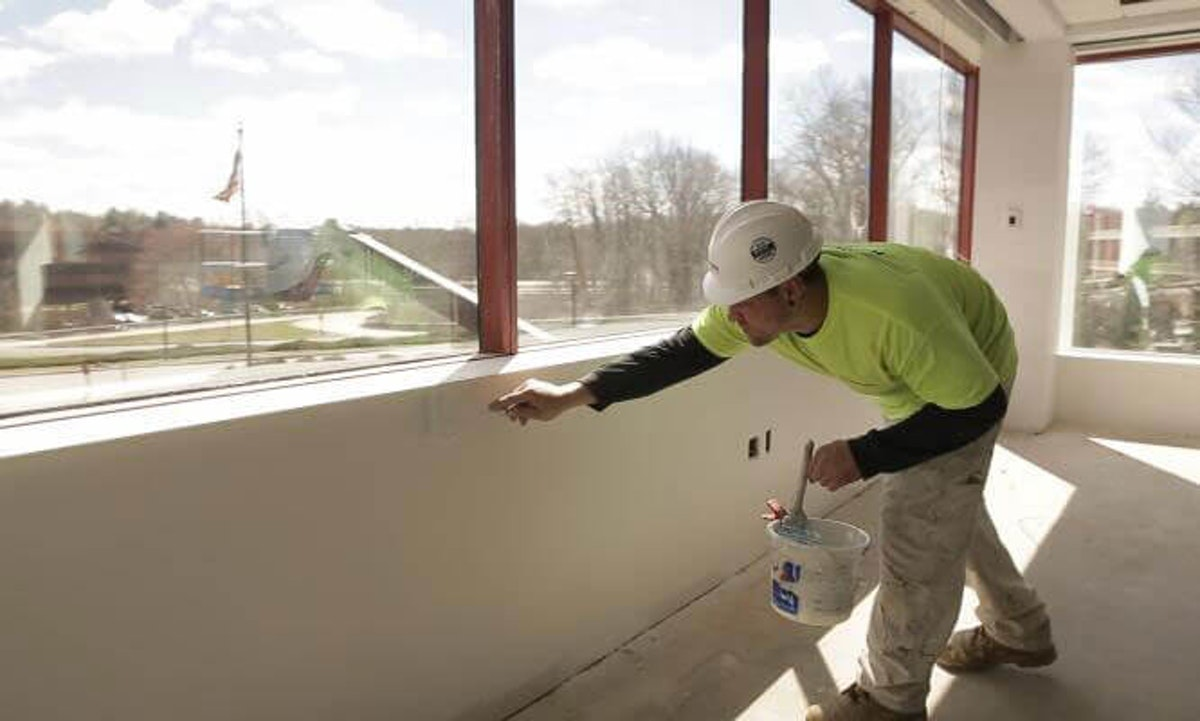 Kaloutas contractor working on caulking services Tips for Selecting Caulk for Your Commercial Painting Project