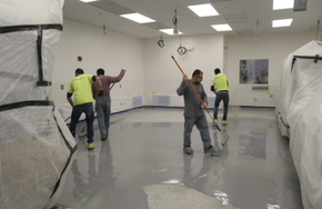 Kaloutas contractors preparing for epoxy coating 3 Steps for Planning Your Epoxy Floor Coating for a High-Traffic Commercial Floor