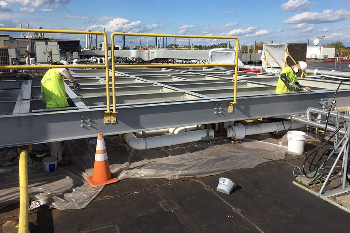 Kaloutas facility maintenance project on steel beams 5 Reasons to Choose a Facility Maintenance Program Over a Project