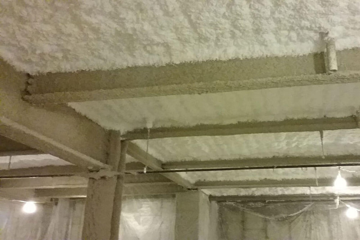 Thermal acoustic insulation on a ceiling The Pros of Fiberglass-Based and Spray-Applied Thermal Acoustical Insulation