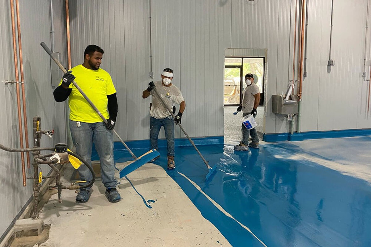 Contractors polishing industrial floors How the Condition and Use of Your Industrial Flooring Determines How to Polish and Maintain Them