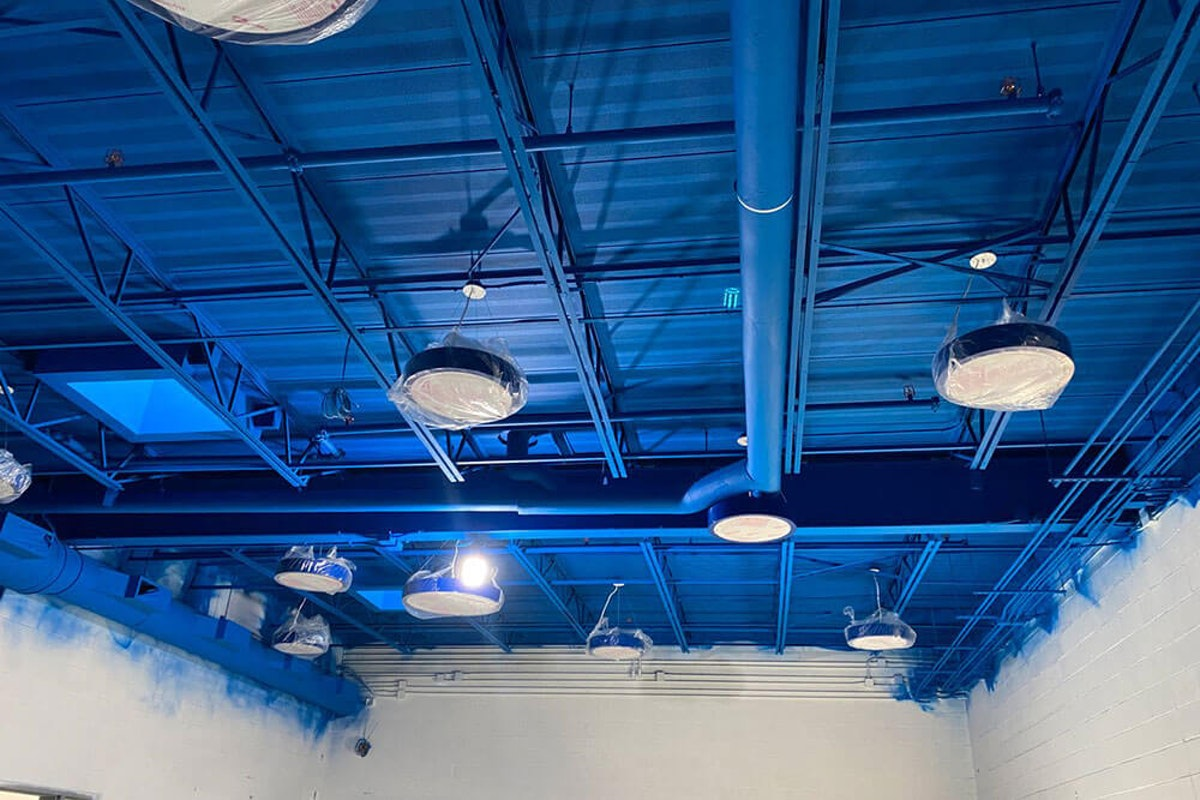 Blue warehouse ceiling after adding intumescent paint How Fire Resistive Paints Can Protect Your Assets