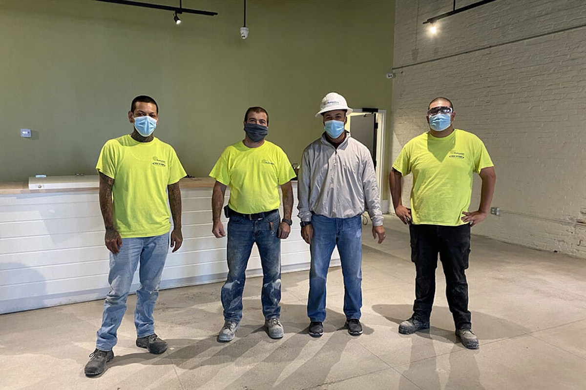 """Kaloutas contractors at a job site How the """"Know, Like, Trust"""" Factor Has Made Kaloutas Successful and the Best in the Business"""