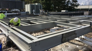 Kaloutas contractors working on steel We Work the Way You Work. Here's How to Get Projects Done on Time and Budget