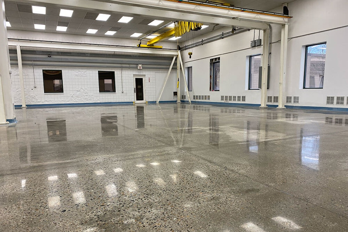 Wet floor polishing work in New England How Wet Concrete Polishing Will Reduce Downtime, Labor, and Yield a Faster Turnaround at Your Facility