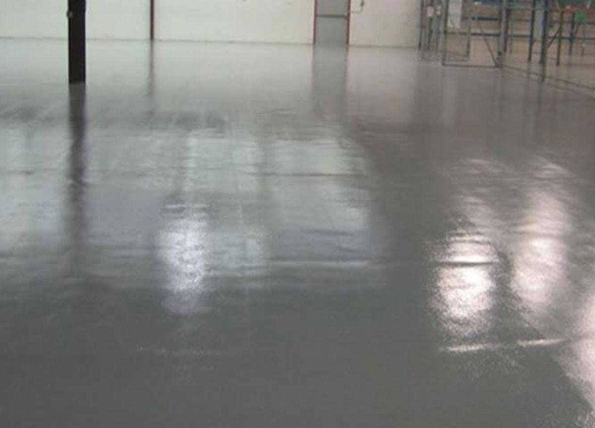 Moisture mitigation service on an industrial floor Moisture Mitigation: How Kaloutas Teams Prevent Concrete Floor Damage